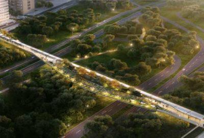 Pedestrian bridge crossing multiple freeway and railway lines