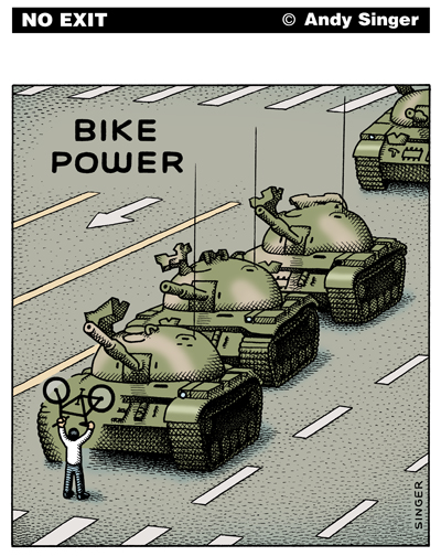 Person in white shirt holding up bicycle in front of line of tanks (as in Tianamen Square)
